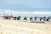 VALE FIGUEIRAS, PORTUGAL - August 16 2014:  Surfers doing excersises on the famous surfers beach Vale Figueiras in Portugal