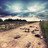 Old Rural Road With Abandoned Shoes