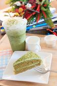 Piece Of Green Tea Cake And Cool Green Tea Ice In Glass Bottle Already To Eating On Table Top