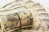 foto of yen  - Close up Japanese Yen banknotes on white background - JPG