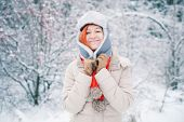 Winter portrait of beautiful Young girl with red hair