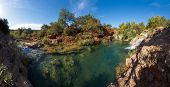 Panorama view of a small waterfalls near the city of Tavira in Algarve, Portugal, Europe