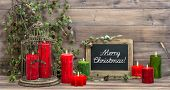 Vintage Christmas Decoration Red Candles And Pine Branch
