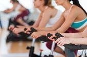 Exercising On Gym Bikes.