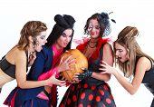 Halloween women with a pumpkin, studio shot