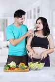 Husband Giving Salad To His Wife