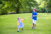Happy Kids Running In A Park