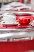 Red Chairs And White Cups