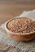 image of buckwheat  - Raw buckwheat seeds in bowl on wooden background - JPG