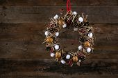 Decorated Christmas Wreath Pine Cones Cotton Buds And Walnuts Old Rustic Background