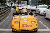 MADRID, SPAIN - OCTOBER 11, 2014: Tourist in a GoCar in the streets of Madrid. GoCar is a two-seater