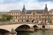 Bridge On Seine River With Louvre Museum Facade