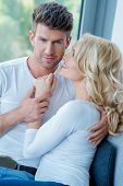 Close up Middle Age Romantic Lovers in White Tops Photo Shoot Inside Home.