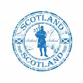 image of bagpipes  - Blue grunge rubber stamp with man silhouette playing the bagpipes and the name of Scotland written inside the stamp - JPG