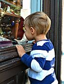 Little boy at shop window