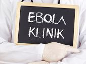 Doctor Shows Information: Ebola Clinic In German Language