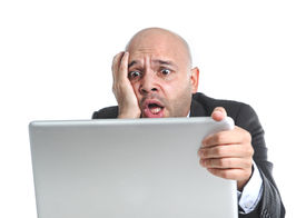 foto of spanish money  - businessman in crisis and stress at computer laptop holding monitor watching online finances drop down or loosing money internet gambling isolated on white background - JPG