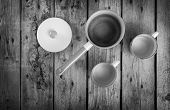 pic of saucepan  - Old cups and saucepan in a retro kitchen table setting in black and white - JPG