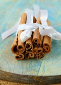 Cinnamon sticks traditional spices on wooden background