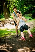 stock photo of seesaw  - Young sport couple having fun  - JPG