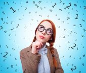 image of redhead  - Redhead teacher in glasses with abstract numbers around - JPG