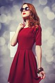 picture of redhead  - Beautiful redhead women with bag and bokeh at background - JPG