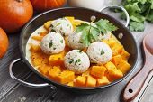 picture of saucepan  - Baked pumpkin and chicken meatballs with herbs in a saucepan - JPG
