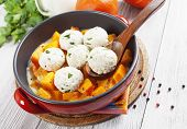 foto of saucepan  - Baked pumpkin and chicken meatballs with herbs in a saucepan - JPG