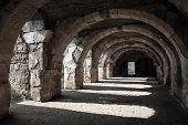 Interior Of Empty Dark Corridor With Arcs
