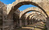 Empty Corridor With Arcs And Blue Sky. Ruins Of Smyrna