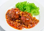 image of veal  - Veal meatballs with bacon in a tomato sauce with mushrooms on white plate - JPG