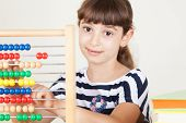 Girl Playing With Colourful Abacus