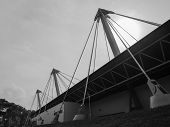 Large Posts Supporting Roof Of Stadium In Black & White