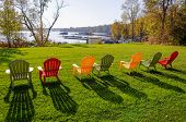 stock photo of lawn chair  - Row of lawn chairs on a green grass background in summer time - JPG