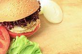 picture of veggie burger  - Vegan sea burger closeup on wooden surface - JPG