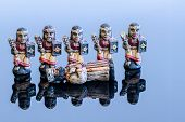 foto of figurines  - chess figurines placed on a blue background - JPG