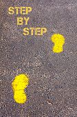 Yellow Footsteps On Sidewalk Towards Step By Step Message
