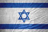stock photo of israeli flag  - Israel flag or Israeli banner on wooden texture - JPG