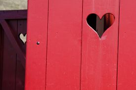 image of outhouse  - the red outhouse with hearts in the door - JPG
