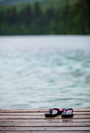 picture of dock a lake  - Flip flops on a Dock in front of a Turquoise Water Lake in the Wild Nature - JPG