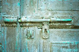 picture of keyholes  - Rusted keyhole on wooden door  - JPG