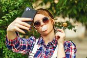 stock photo of lollipop  - The girl photographed himself on a mobile phone - JPG