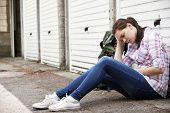foto of homeless  - Homeless Teenage Girl On Streets With Rucksack - JPG