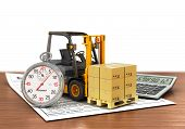 stock photo of forklift  - Forklift truck with boxes and stopwatch - JPG