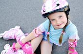 picture of roller-skating  - Cute smiling little girl in pink roller skates and protective gear outdoor - JPG