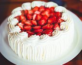 foto of whipping  - Delicious strawberry cake with strawberries and whipped cream - JPG