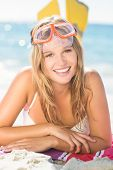 stock photo of flipper  - pretty blonde with snorkel and flippers at the beach - JPG