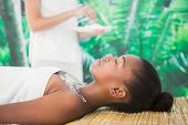 stock photo of scrubs  - Pretty woman lying on massage table with salt scrub on the chest - JPG