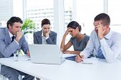 stock photo of concentration  - Concentrated business people in discussion in an office - JPG