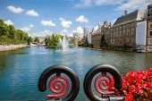 pic of prime-minister  - View of the Hofvijver and the Binnenhof in The Hague in the foreground an iron railing with flower arrangement - JPG